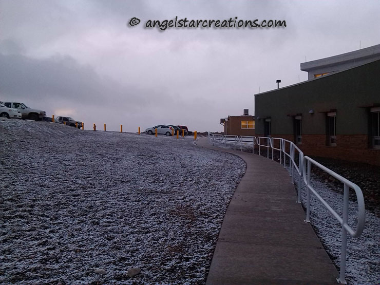 Photo: Buildings and sidewalk with a sprinkling of snow