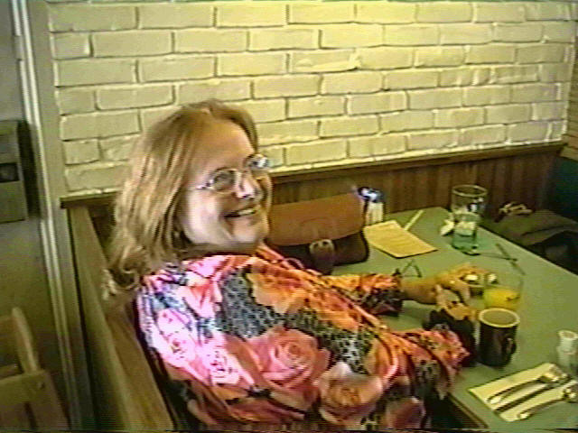 Image: Smiling woman sitting in a restaurant