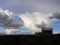 Image: House with clouds in Northern New Mexico
